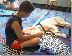 6-20-09 Trey reads to his dog (r)